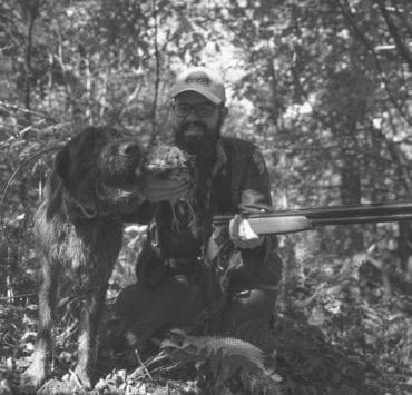 A.J. DeRosa, founder of Project Upland with his bird dog Grim