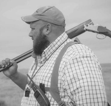 Brandon Moss a Sage Grouse Hunter in Montana in the field.