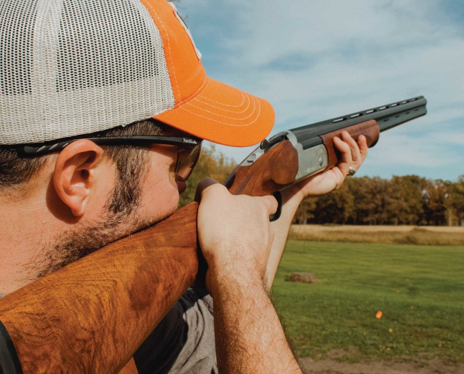 A hunter brakes clays with a Stevens 555E