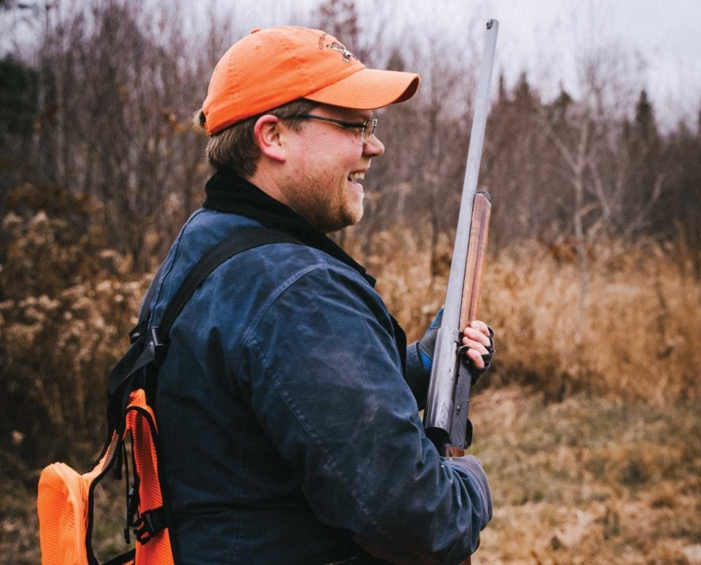 A hunter carries a Browning Auto 5 Humpback