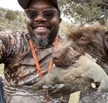 Eric Thompson, co-creator of Hardwired Outdoors hunting chukar with his dog.