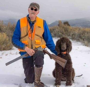 Russell Dodd and Irish Water Spaniel pheasant hunting in the snow